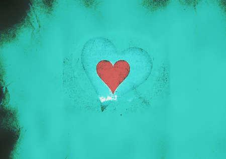 Red valentine heart on a light blue grunge background Stock Photo