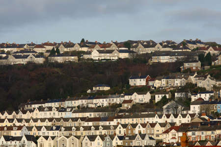 Traditional terraced houses on a hill photo