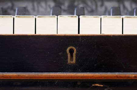 Old piano keys close up with keyhole photo