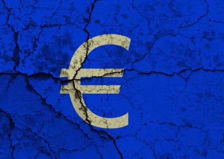 Euro symbol on a cracked grunge background Stock Photo