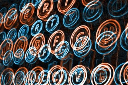 Neon typewriter keys close up, selective focus