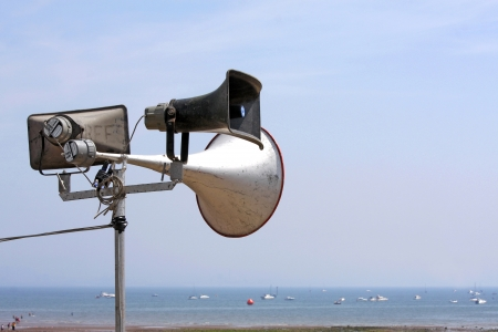 Outdoor public address speakers on a summer beach Stock Photo