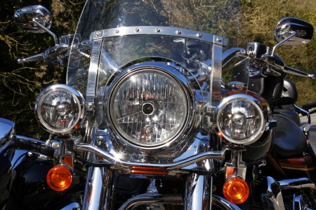 headlamp: Front view of a classic motorcycle headlamp and screen