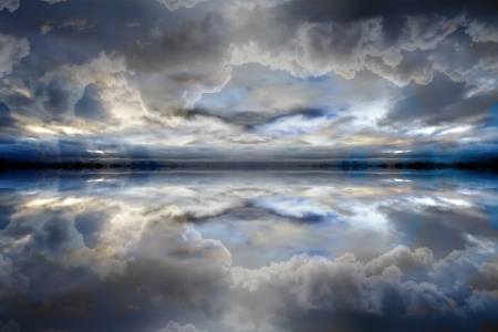 Dark blue reflected clouds background