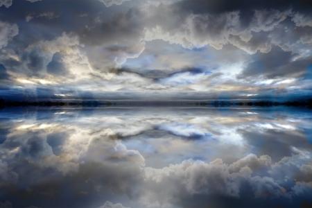 Dark blue reflected clouds background