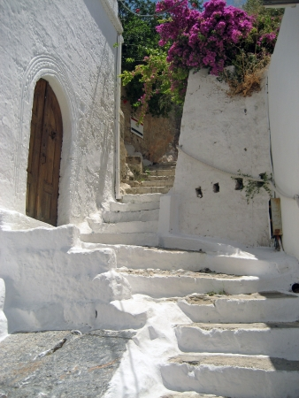 Old and worn whitewashed steps in a Greek town photo
