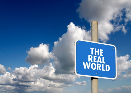 The real world signpost with blue sky and clouds Stock Photo
