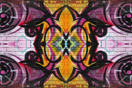 Colourful abstract graffiti on a brick wall background