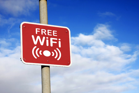 Free WiFi sign against a blue sky