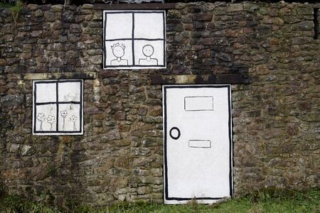 boarded: Cartoon windows and door painted on an abandoned building