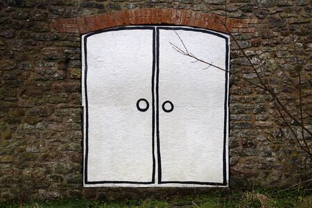 Cartoon double door outline painted on a boarded up entrance