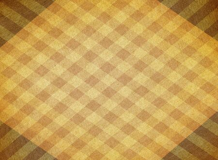 faded: Faded brown and yellow chequered canvas background