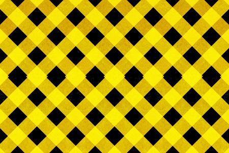 criss cross: Yellow textured criss cross pattern on a black background Stock Photo