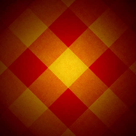 grubby: Red and yellow fabric diamond pattern with spotlight