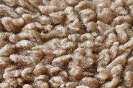 Beige carpet fibres close up, macro detail