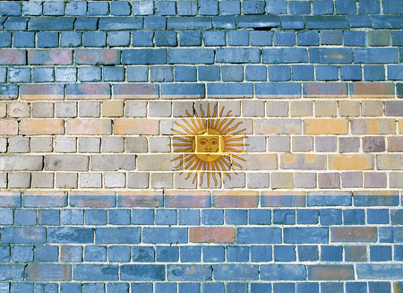 Argentinian flag on an old brick wall background