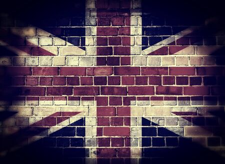 Desaturated Union flag on a brick wall background with a dark vignette 版權商用圖片