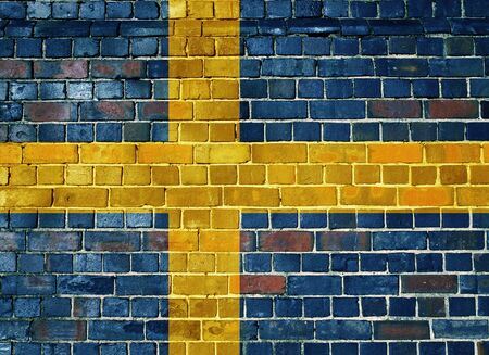 Swedish flag on an old brick wall background