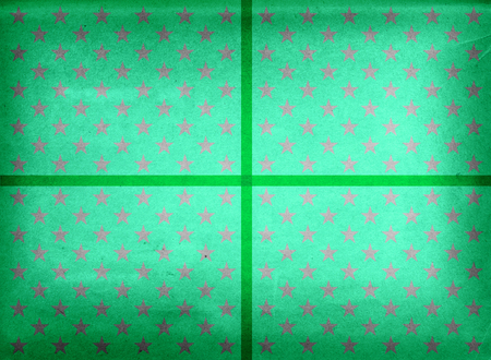 Green wrapping paper with stars and ribbon Stock Photo
