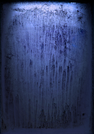 Old window with streaked paint at night with a blue outside light