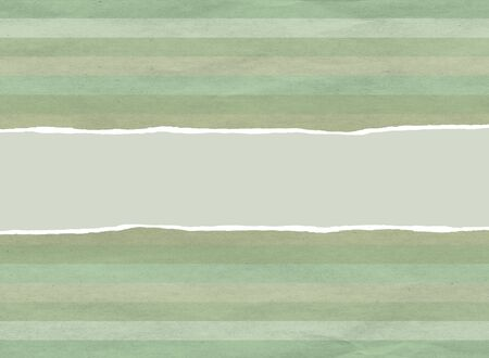 Vintage faded green christmas wrapping paper with centre tear Stock fotó