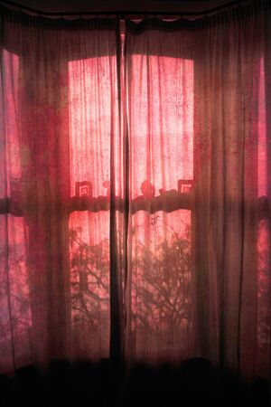 Old grunge windows with red light