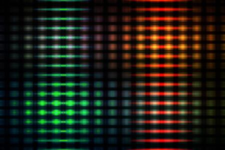 Green and red blurred glowing lights on a black background