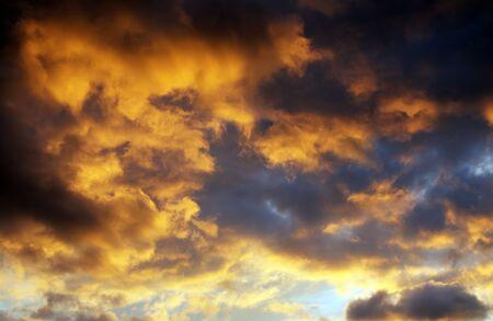 Dramatic orange clouds at sunset background