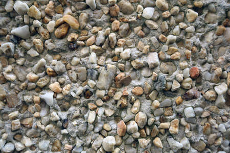 Pebbledash and concrete wall render close up background texture