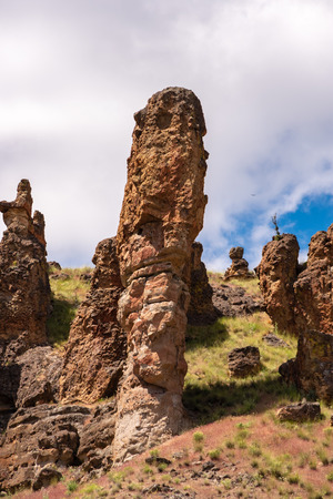 Majestic rock formations thrust from the ground at the John Day National Monument Clarno Unit. 18 miles west of Fossil Oregon. Volconic lahars formed over 40 million years ago. Stock Photo