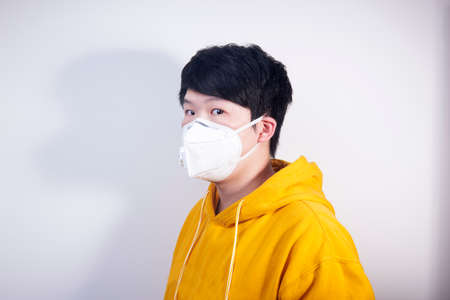 A man wearing a N95 medical protective mask