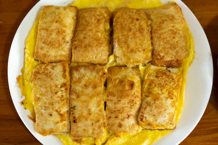 A plate of Chinese family dishes, tofu, tofu omelette