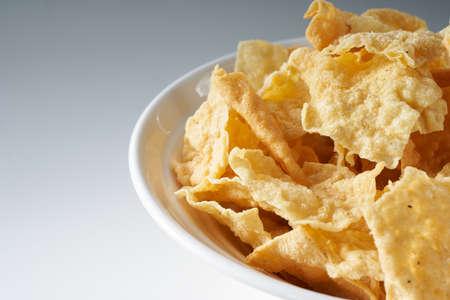 Closeup of a bowl of golden tempting fried yuba