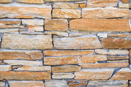 Brown-yellow stone brick wall background