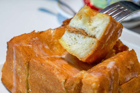 Classic dessert in Hong Kong tea restaurant, deep-fried western toast with condensed milk and peanut sauce