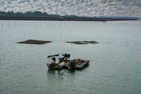 Fishing boats and bamboo fishing nets for fishermen by the sea