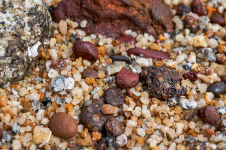 Macro close-up of gravel stones on the beach by the sea