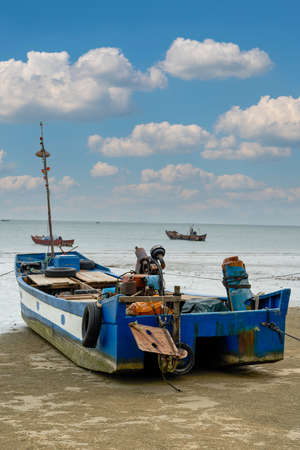 Close-up of fishing boats docked on the beach by the sea