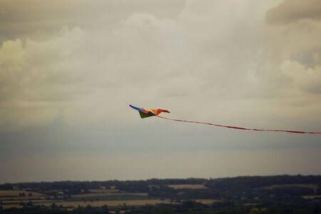 horison: Smaill kite against horison Stock Photo