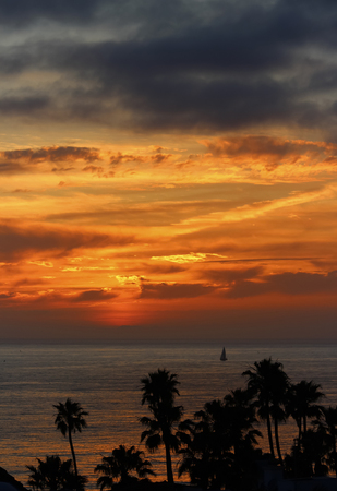 San Clemente Sunset Vertical with Sailboat Stock Photo