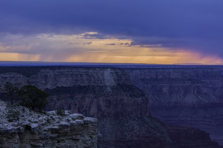 Grand Canyon - Rain Shear on Distant Mountains - Pullback Stock Photo