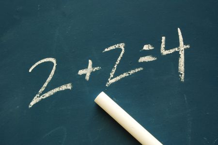 A Chalkboard And Chalk With A Math Problem Stock Photo, Picture And ...
