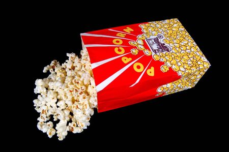 buttery: Popcorn and popcorn bag on black
