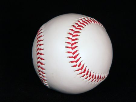 A baseball on a black background