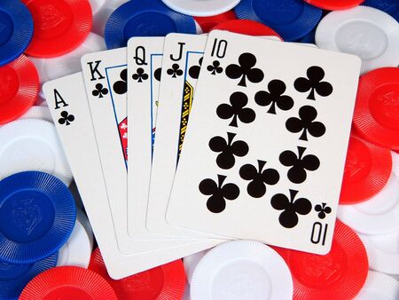 A poker hand on a pile of gambling chips