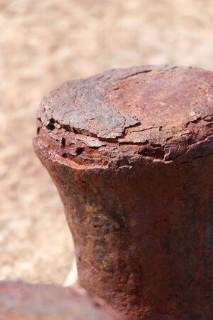 Rusty bollard in a harbour 版權商用圖片