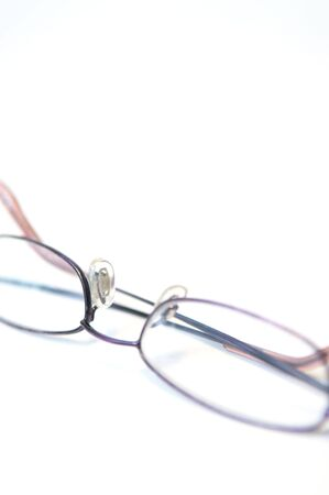 Shallow focus high-key shot of reading glasses Stock fotó