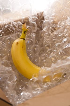 Closeup of banana in bubble wrap and carton photo