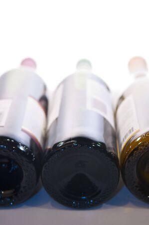 Three wine bottles shot from bottom photo