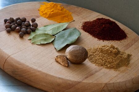 Arrangement of several different spices on a wooden surface Stock Photo